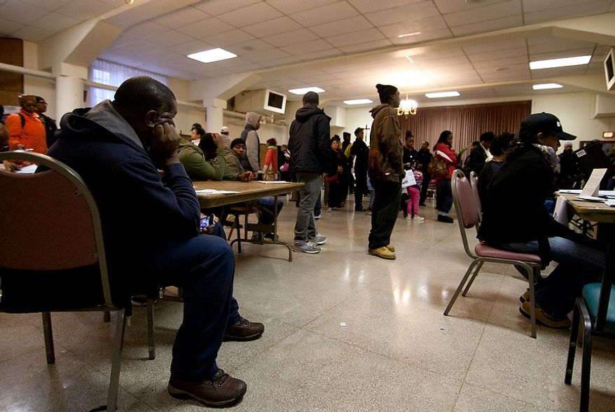 Voters wait in long lines to cast their ballots at St. Francis Church, precinct 111 polling site in Washington, D.C., to cast their vote, Tuesday, Nov. 6, 2012 (Craig Bisacre/The Washington Times)