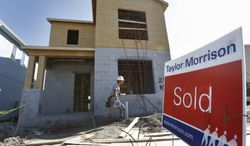 """A """"sold"""" sign sits in front of a home under construction in Riverview, Fla., on Wednesday, Sept. 26, 2012. (AP Photo/Chris O'Meara)"""