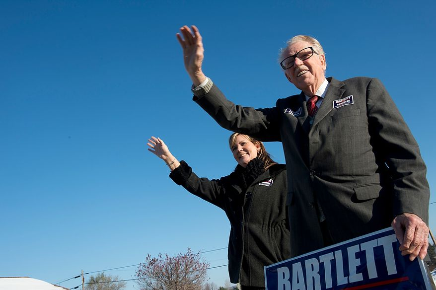 Maryland Rep. Roscoe Bartlett, a Republican who represents the state's sixth Congressional district, waves to voters with Debbie Burrell, his chief of staff, outside of Grantsville Elementary School in Grantsville, Md. on Election Day, Nov. 6, 2012. Bartlett, who is in a tight race against Democrat John Delaney, is visiting every county in his district on Election Day. (Barbara L. Salisbury/The Washington Times)