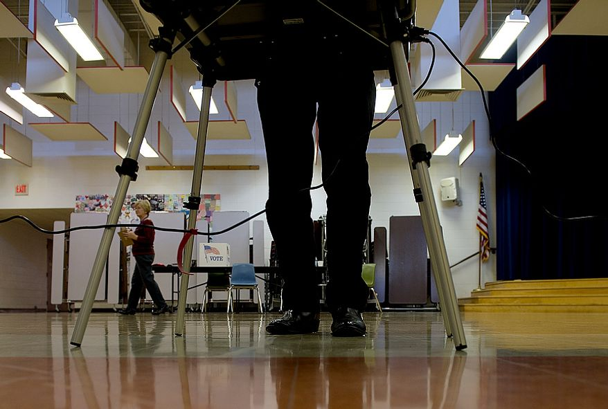A voter casts his ballot on Election Day at Grantsville Elementary School in Grantsville, Md., on Nov. 6, 2012. (Barbara L. Salisbury/The Washington Times)
