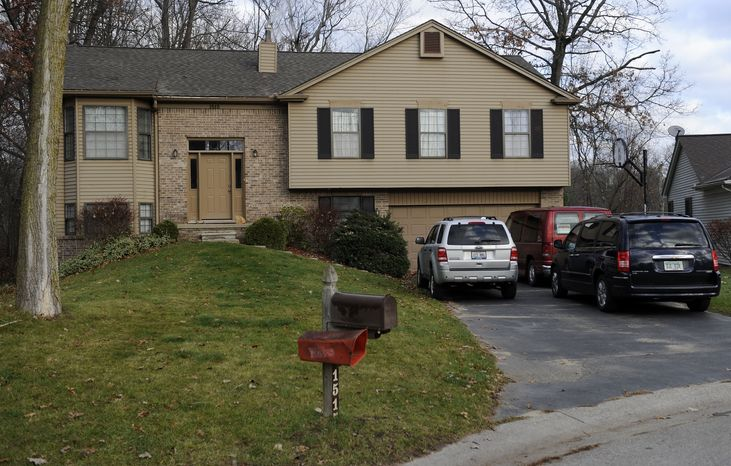 Law enforcement officers investigating a shooting spree that included 24 incidents and one injury in four Michigan counties executed a search warrant at this home in Wixom, Mich., police said on Tuesday, Nov. 6, 2012. (AP Photo/The Detroit News, David Coates)