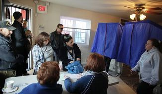 People cast their votes, Tuesday, Nov. 6, 2012, at a 1st Ward polling location in South Philadelphia. (AP Photo/ Joseph Kaczmarek)