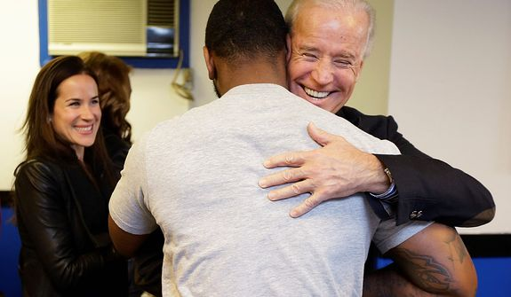 Vice President Joe Biden hugs a patron  during a visit to the Landmark Restaurant, Tuesday, Nov. 6, 2012, in Cleveland, Ohio. Biden's  daughter Ashley is at left. (AP Photo/Matt Rourke)