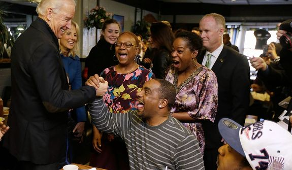 Vice President Joe Biden, accompanied by his wife Jill Biden, meets with patrons during a visit to the Landmark Restaurant, Tuesday, Nov. 6, 2012, in Cleveland, Ohio. (AP Photo/Matt Rourke)