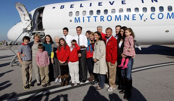 Republican presidential candidate, former Massachusetts Gov. Mitt Romney and his running mate Rep. Paul Ryan, R-Wis., pose with members of Ryan's family at Cleveland Hopkins International airport, Tuesday, Nov. 6, 2012 in Cleveland, Ohio.  (AP Photo/Mary Altaffer)