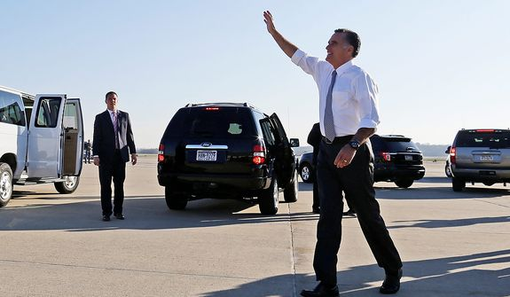 Republican presidential candidate former Massachusetts Gov. Mitt Romney waves to a crowd gathered at a nearby parking lot after his campaign plane arrived at Moon Township Pittsburgh International Airport in Coraopolis, Pa., Tuesday, Nov. 6, 2012. (AP Photo/Charles Dharapak)