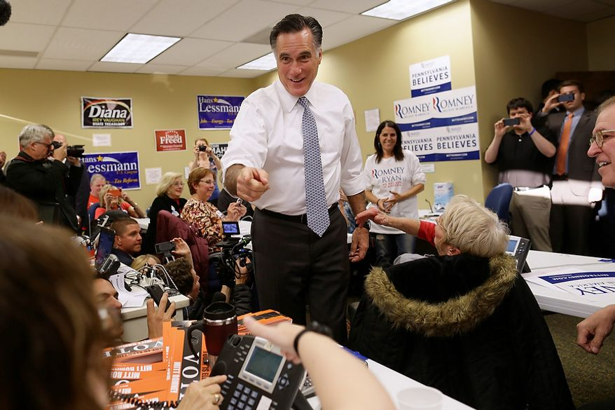 Republican presidential candidate,former Massachusetts Gov. Mitt Romney visits a campaign call center in Green Tree, Pa., Tuesday, Nov. 6, 2012. (AP Photo/Charles Dharapak)