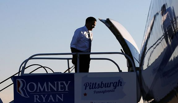Republican presidential candidate, former Massachusetts Gov.  Mitt Romney returns to his campaign plane at Moon Township Pittsburgh International Airport in Coraopolis, Pa., after he visited a call center in the Pittsburgh area, Tuesday, Nov. 6, 2012. (AP Photo/Charles Dharapak)
