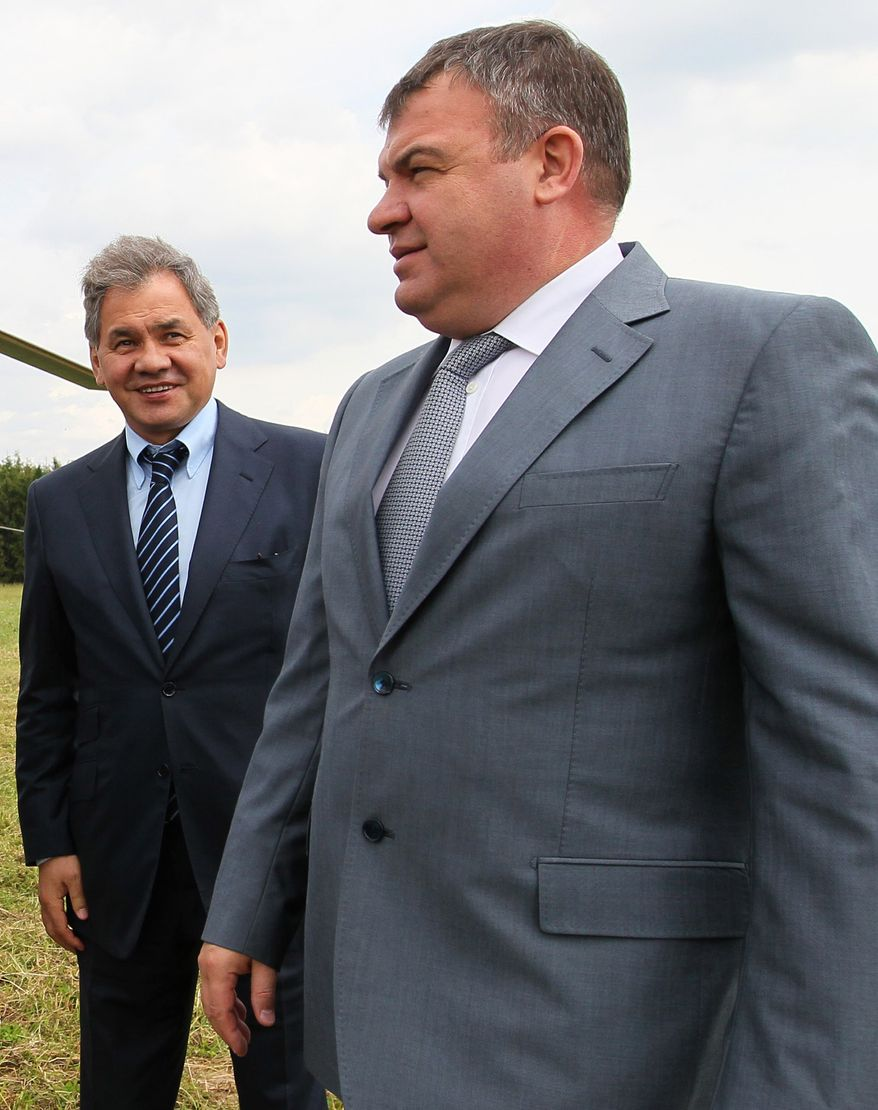 **FILE** Moscow region governor Sergei Shoigu (right) and Defense Minister Anatoly Serdyukov arrive June 26, 2012, at the village of Petrovskopye, Moscow, for a meeting on the transferal of some of the military assets into civilian hands. (Associated Press/RIA Novosti, Yekaterina Shtukina, Government Press service)