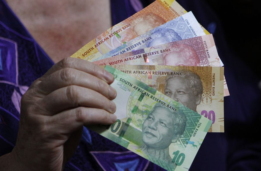 New South African banknotes bearing the image of former President Nelson Mandela went into circulation on Tuesday, Nov. 6, 2012. (AP Photo/Denis Farrell)
