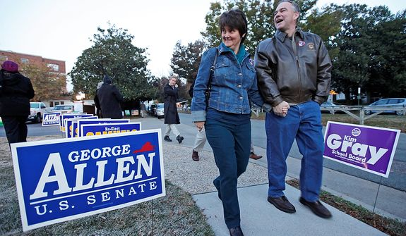 Democratic U.S. Senate candidate and former Virginia Gov. Timothy Kaine and his wife, Anne Holton, walk back home after voting in Richmond, Va., on Nov. 6, 2012. (Associated Press)