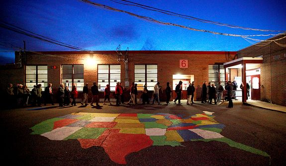 Voters make their way into the polling station at Washington Mill Elementary School in Alexandria, Va., on Nov. 6, 2012, just after the station opened at 6 a.m. (Eva Russo/Special to The Washington Times)