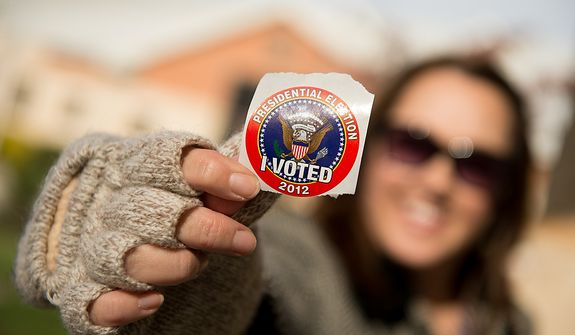 "Ina Moses of Richmond, Va., shows off her ""I Voted"" sticker as she finishes voting at Linwood Holton Elementary School on election day morning, Richmond, Va., Tuesday, November 6, 2012. (Andrew Harnik/The Washington Times)"