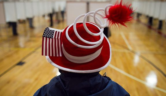 Susan Mardas celebrates Election Day by wearing a festive hat Tuesday, Nov. 6, 2012, while waiting for her mother to vote in Scarborough, Maine. (AP Photo/Robert F. Bukaty)
