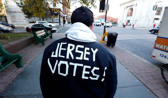 Ed Lippman, 58, wears a message on his jacket on Election Day while walking home, Tuesday, Nov. 6, 2012, in Hoboken, N.J. (AP Photo/Julio Cortez)