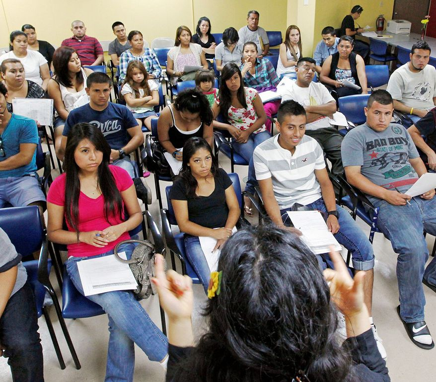 Charlene Gomez leads an orientation seminar for illegal immigrants in Los Angeles. Schools and consulates have been flooded with requests for documents since the Obama administration earlier this year said many young illegal immigrants may be eligible for two-year renewable work permits. (Associated Press)