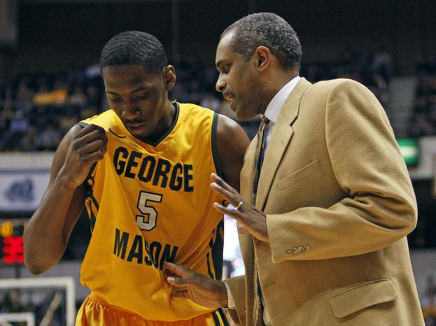 George Mason head basketball coach, Paul Hewitt, right, talks with forward Jonathan Arledge (5) during the first half of an NCAA Colonial Athletic Association semifinal college basketball game in Richmond, Va., Sunday, March 4, 2012. (AP Photo/Stev