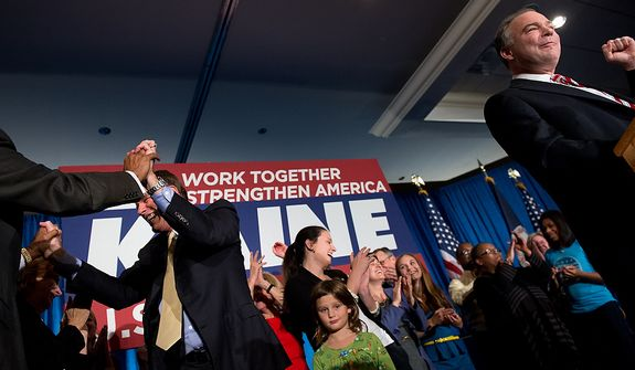 Sen. Mark Warner (D-Va.), left, cheers on Tim Kaine (D), right, as he delivers his victory speech after winning the Virginia election for U.S. Senate at his election night party at the Richmond Marriott, Richmond, Va., Tuesday, November 6, 2012. (Andrew Harnik/The Washington Times)