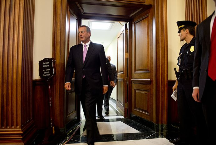 House Speaker John Boehner, Ohio Republican, walks through the Capitol in Washington on Nov. 7, 2012, before speaking with reporters about the fiscal cliff and the need for both parties to find common ground and take steps together to help our economy grow and create jobs, which he says is critical to solving the national debt. (Barbara L. Salisbury/The Washington Times)