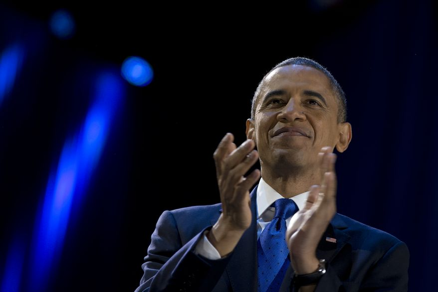 President Obama pauses as he speaks to the cheering crowd at his election-night victory party at McCormick Place in Chicago on Wednesday, Nov. 7, 2012. (AP Photo/Carolyn Kaster)