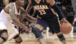 Indiana Pacers' Danny Granger, right, drives past Cleveland Cavaliers' Alonzo Gee during the first quarter of an NBA preseason basketball game Tuesday, Oct. 23, 2012, in Cleveland. (AP Photo/Tony Dejak)