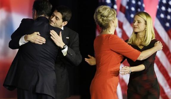 Republican presidential candidate and former Massachusetts Gov. Mitt Romney embraces Republican vice presidential candidate, Rep. Paul Ryan, R-Wis., as  Ann Romney and Janna Ryan embrace after Romney conceded the race during his election night rally, Wednesday, Nov. 7, 2012, in Boston.(AP Photo/David Goldman)