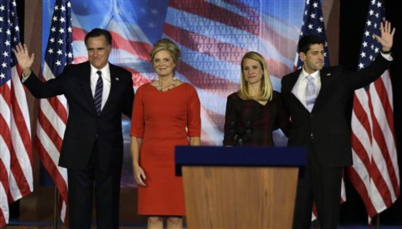 Republican presidential candidate and former Massachusetts Gov. Mitt Romney,   his wife Ann Romney, left and Republican vice presidential candidate, Rep. Paul Ryan, R-Wis., and his wife Janna wave to supporters on stage during Romney's election night rally, Wednesday, Nov. 7, 2012, in Boston. (AP Photo/David Goldman)