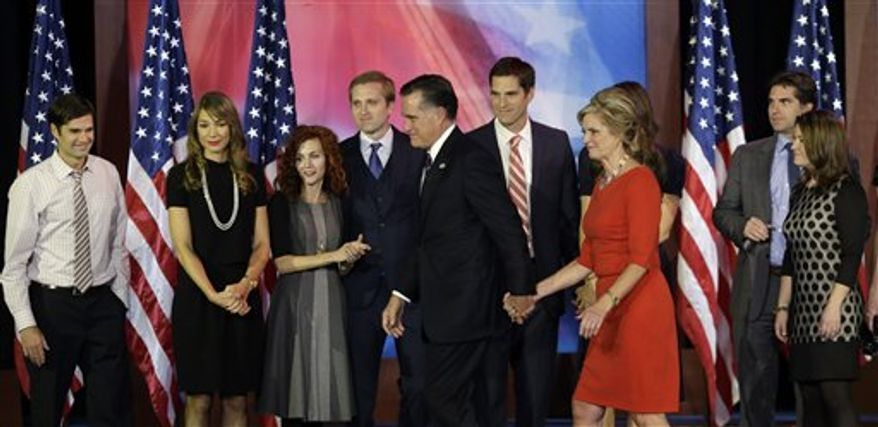 Republican presidential candidate and former Massachusetts Gov. Mitt Romney and his wife Ann, center, are joined by their sons and their wives on stage after Romney conceded the race during his election night rally, Wednesday, Nov. 7, 2012, in Boston. (AP Photo/Elise Amendola)