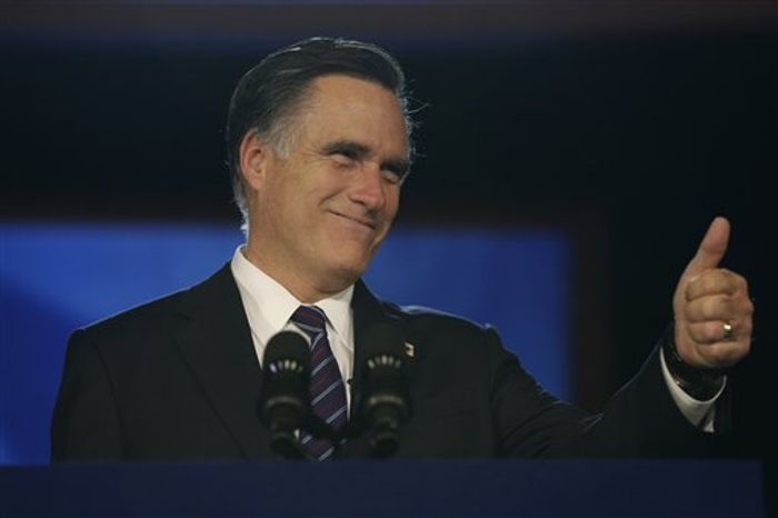 Republican presidential candidate Mitt Romney gives a thumbs up as he arrives to give his concession speech during his election night rally in Boston on Nov. 7, 2012. (Associated Press)