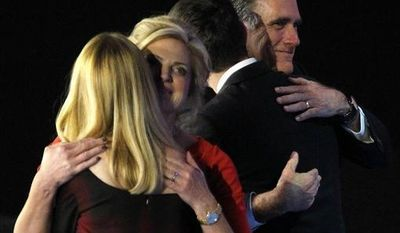 Republican presidential candidate Mitt Romney embraces his running mate Paul Ryan as Romney's wife, Ann, and Ryan's wife, Janna, embrace Nov. 7, 2012, after Romney conceded the race during his election night rally in Boston. (Associated Press)