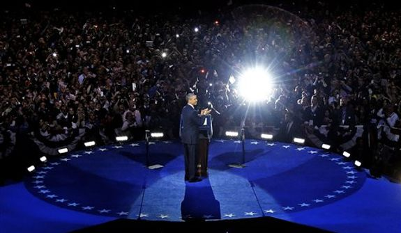 President Barack Obama acknowledges the crowd at his election night party Wednesday, Nov. 7, 2012, in Chicago. President Obama defeated Republican challenger former Massachusetts Gov. Mitt Romney. (AP Photo/M. Spencer Green)