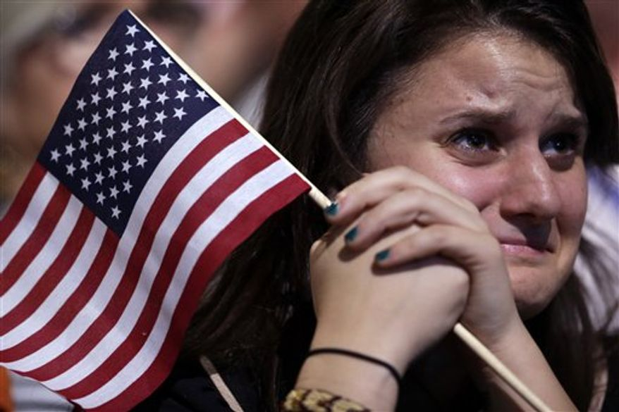 A supporter cries as President Barack Obama speaks during an election night party, Wednesday, Nov. 7, 2012, in Chicago. Obama defeated Republican challenger former Massachusetts Gov. Mitt Romney. (AP Photo/Matt Rourke)