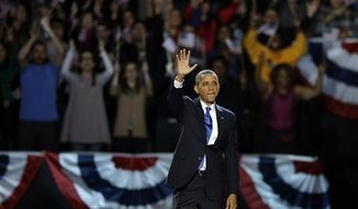President Barack Obama waves at his election night party Wednesday, Nov. 7, 2012, in Chicago. President Obama defeated Republican challenger former Massachusetts Gov. Mitt Romney. (AP Photo/Chris Carlson)