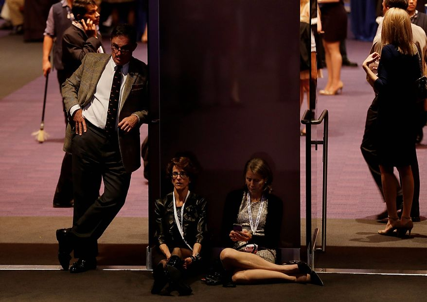 Supporters wait for returns during Republican presidential candidate and former Massachusetts Gov. Mitt Romney's election night rally, Tuesday, Nov. 6, 2012, in Boston. (AP Photo/Elise Amendola)