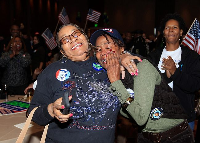 Anita Flanigan, left, and Renee Drake react after President Obama reaches the 270 Electoral College votes during the Michigan Democratic election night party at the