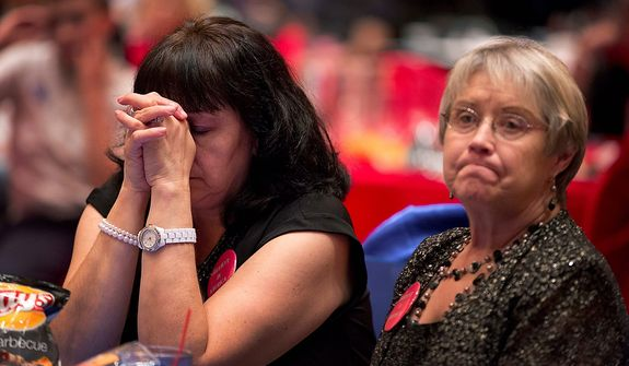 Mitt Romney supporter and campaign volunteer Lynn Short, right, and a supporter who wished not to be identified, react as they watch presidential election returns at a GOP watch party, Tuesday, Nov. 6, 2012, in Las Vegas. (AP Photo/Julie Jacobson)