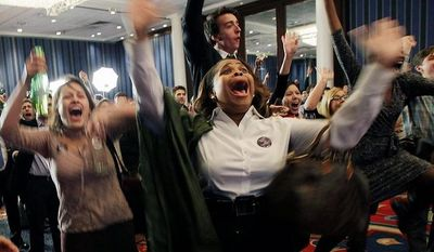 Supporters of President Barack Obama, including Tankia Inlaw, center, and Heather Alexa Woodfield, left, celebrate at New York State Democratic Headquarters following Election Day, Tuesday, Nov. 6, 2012. (AP Photo/Kathy Willens)