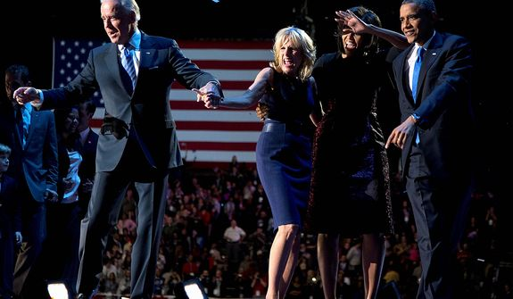 President Barack Obama with first last Michelle Obama, Vice President Joe Biden and Jill Biden celebrate on stage at the election night party at McCormick Place, Wednesday, Nov. 7, 2012, in Chicago. Obama defeated Republican challenger former Massachusetts Gov. Mitt Romney.(AP Photo/Carolyn Kaster)