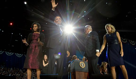 President Barack Obama with first last Michelle Obama, Vice President Joe Biden and Jill Biden celebrate on stage at the election night party at McCormick Place, early Wednesday, Nov. 7, 2012, in Chicago. Obama defeated Republican challenger former Massachusetts Gov. Mitt Romney. (AP Photo/Carolyn Kaster)