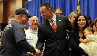 ** FILE ** Republican candidate for the U.S. Senate Dan Bongino shakes hands with a supporter at the Republican election party Tuesday, Nov. 6, 2012, in Linthicum, Md. Also pictured at right is Paula Bongino and Amelia Bongino.(AP Photo/Gail Burton).