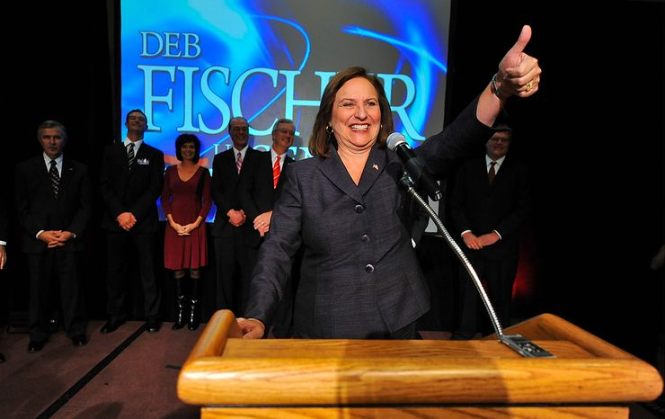 State Rep. Deb Fischer, R-Lincoln, gestures to supporters during an election night party in Lincoln, Neb., Tuesday, Nov. 6, 2012. Fischer has been elected to the U.S. Senate, completing a remarkable eight-year journey from little-known state legislator. (AP Photo/Dave Weaver)