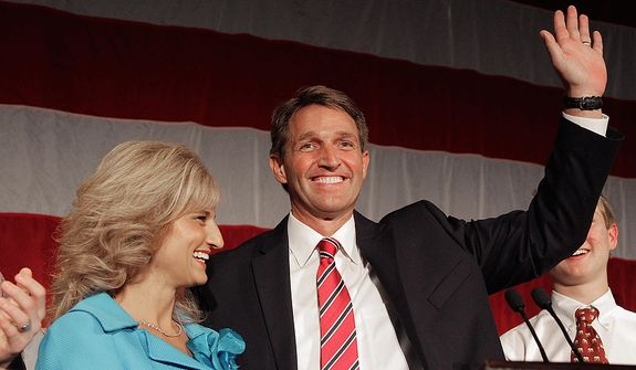 U.S. Rep. Jeff Flake, R-Ariz., and his wife Cheryl, wave during an election night party, Tuesday, Nov. 6, 2012, at a hotel in Phoenix. Flake is seeking retiring Sen. Jon Kyl's Senate seat along with democratic challenger Richard Carmona. (AP Photo/Matt York)