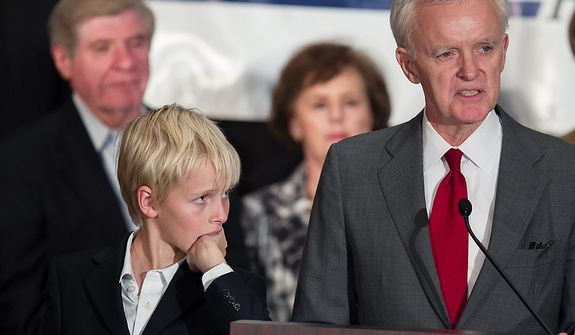Watched by his son Henry, Democratic Senate candidate Bob Kerrey delivers his concession speech at the Nebraska Democratic Party's election night gathering, in La Vista, Neb., Tuesday, Nov. 6, 2012. Kerrey lost his election bid to Republican Deb Fischer. Rear left is retiring Sen. Ben Nelson, D-Neb. (AP Photo/Nati Harnik)