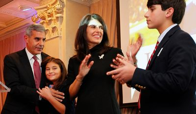 State Sen. Joe Kyrillos, Republican candidate for U.S. Senate, with his daughter Georgia, wife Susan and son Max by his side, waves after giving his concedes to Democratic incumbent Bob Menendez, at his election night headquarters at Nanina's in the Park in Belleville, N.J., Tuesday, Nov. 6, 2012. (AP Photo/Rich Schultz)