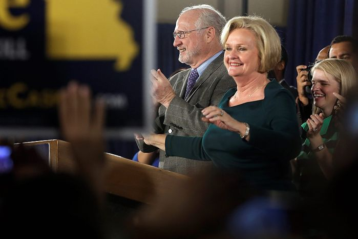 Sen. Claire McCaskill, D-Mo., smiles as she stands next to her husband, Joseph Shepard, while declaring victory over challenger Rep. Todd Akin, R-Mo., in the Missouri Senate race Tuesday, Nov. 6, 2012, in St. Louis. (AP Photo/Jeff Roberson)