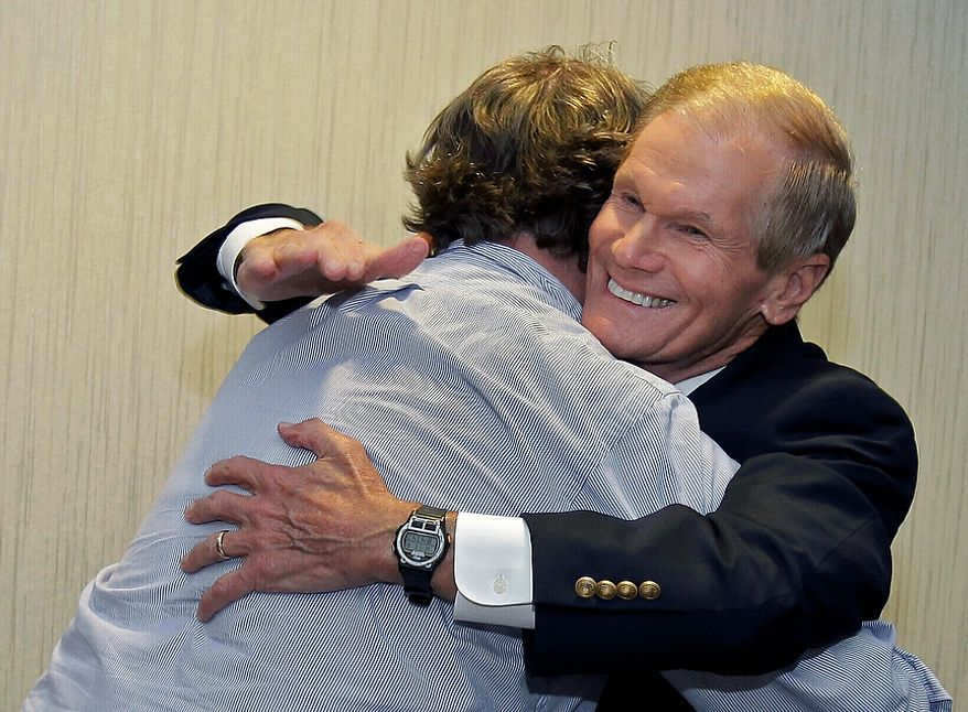 U.S. Sen. Bill Nelson, D-Fla., right, hugs a member of his campaign staff after he was declared the projected winner in his senate race, Tuesday, Nov. 6, 2012, in Orlando, Fla. (AP Photo/John Raoux)
