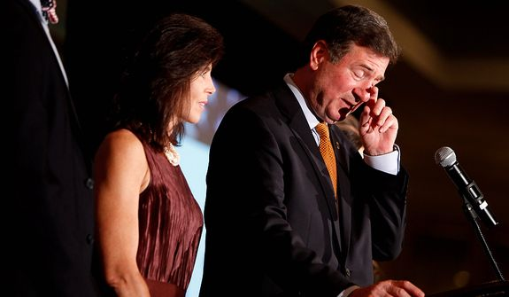 George Allen, joined by his family, gives his concession speech Tuesday night, Nov. 6, 2012, in Richmond, Va. Allen, a Republican, lost the race for the U.S. Senate seat to Democrat Tim Kaine. (AP Photo/Richmond Times-Dispatch, Dean Hoffmeyer)