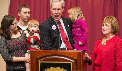 While carrying his 5-year-old granddaughter Keira Wade, Kevin Wade, center, Delawareís GOP nominee for the United States Senate, concedes to his opponent, Democratic incumbent Sen. Tom Carper during election night, Tuesday, Nov. 6, 2012 at the Dover Downs Hotel and Casino in Dover, Del. Wade's family stands next to him for support: wife Gail, right, his daughter Lauren, left, with her husband Anton and their 1-year-old son Owen. (AP Photo/Ron Soliman)
