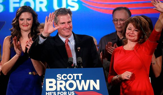 U.S. Sen. Scott Brown, R-Mass., center, waves to the crowd at the conclusion of a concession speech as his daughter Ayla Brown, left, applauds and wife Gail Huff, right, waves at an election night watch party in a hotel in Boston, Tuesday, Nov. 6, 2012. Brown lost to Democratic challenger Elizabeth Warren in his bid for re-election to the U.S. Senate. (AP Photo/Steven Senne)