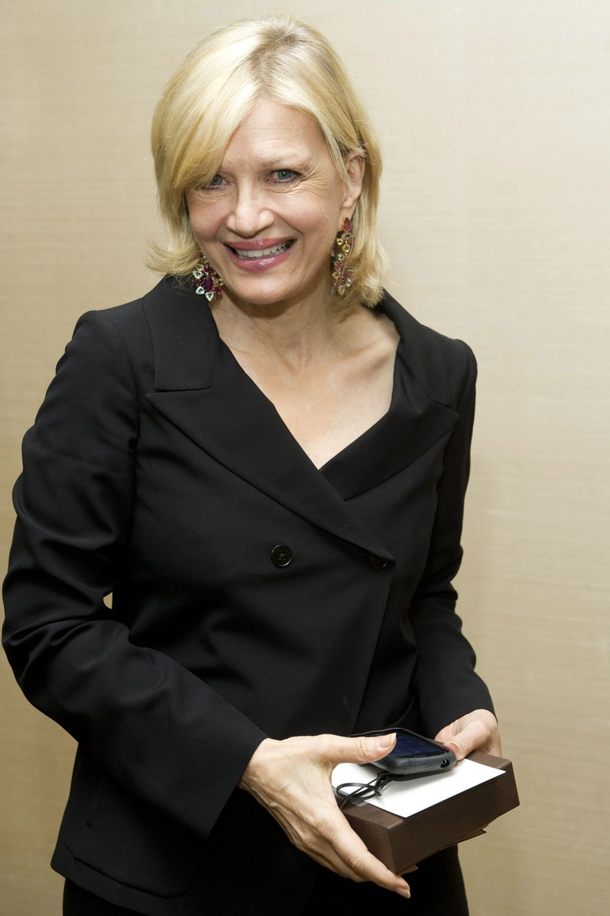 **FILE** Diane Sawyer attends Aretha Franklin's 70th birthday party in New York on March 24, 2012. (Associated Press)